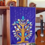 Tree of Life positively glows against a purple background. My runner is shown on the pulpit and in the book, Jewish Threads.