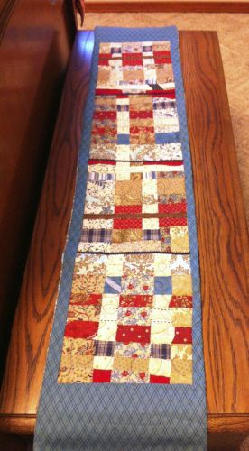 So cool how Tammi cut up, rearranged, and finished her Skinny quilt...